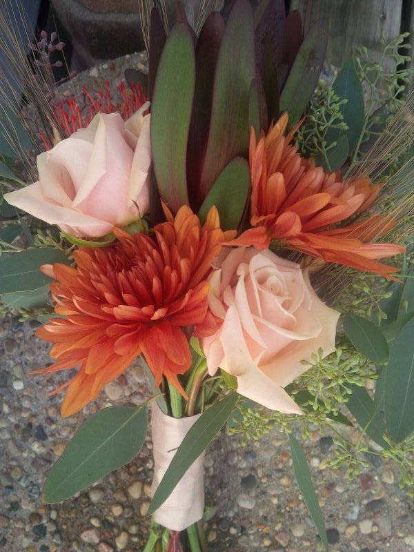 Bouquet of roses, pin cushion protea, leucadendron, mums, silk tulip