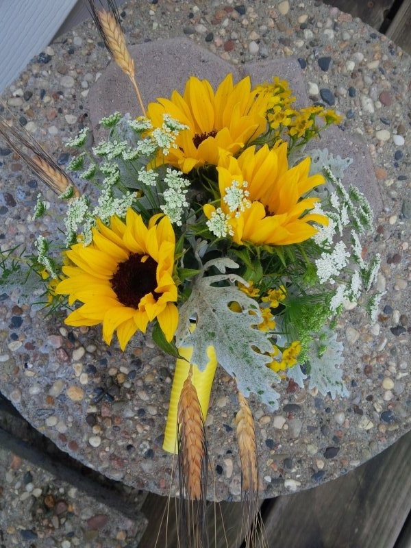 Sunflower bouquet with dusty miller, wheat