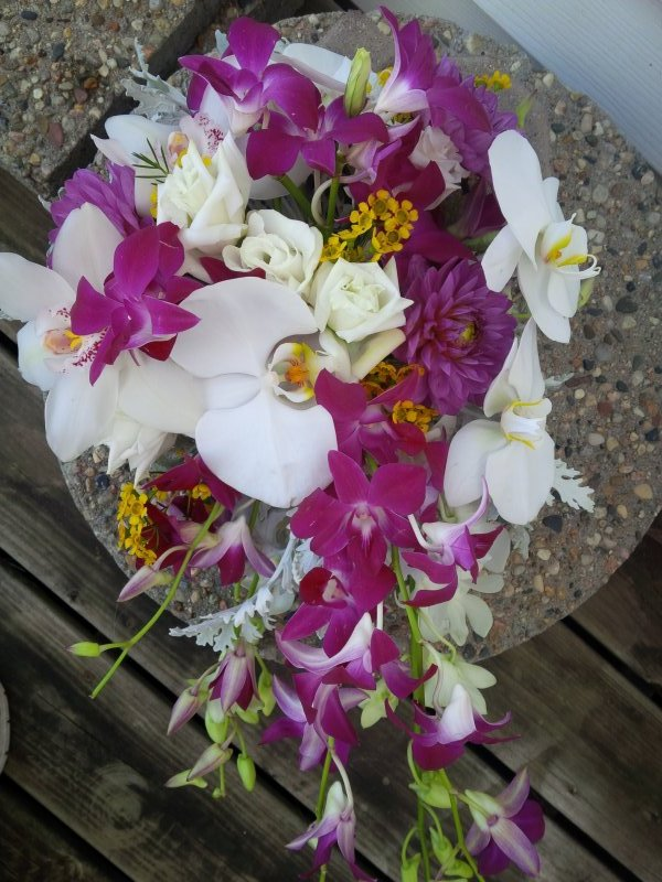 Bouquet of orchids with a hint of yellow wax