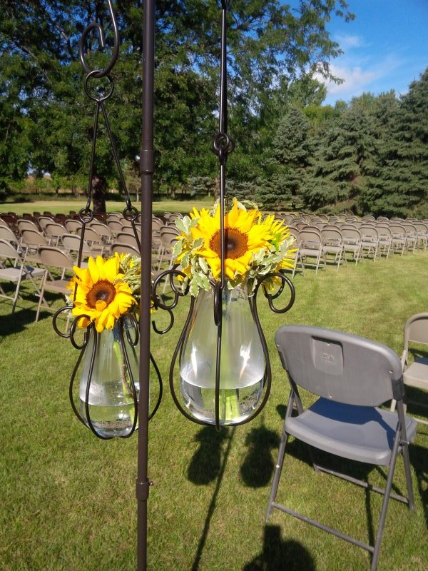 Rental decor with sunflower centerpieces
