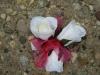 wristlet of white spray roses
