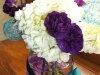 fresh centerpieces: white hydrangeas with purple mini carnations and teal spheres