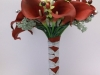 silk bouquet with white roses, red calla lilies, seeded eucalyptus, berries