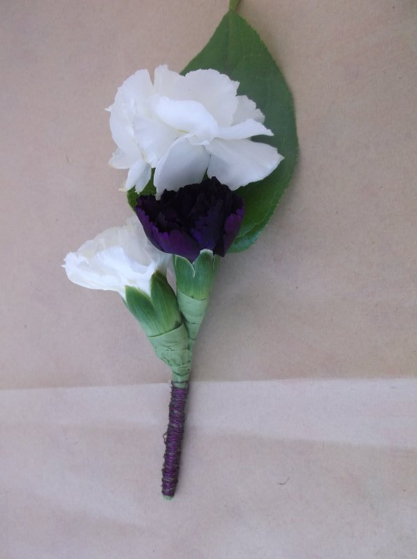 Corsage with mini carnations stem wrapped in wire