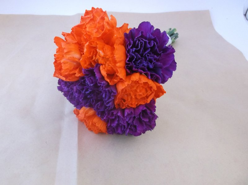 Bouquet of orange and purple carnations