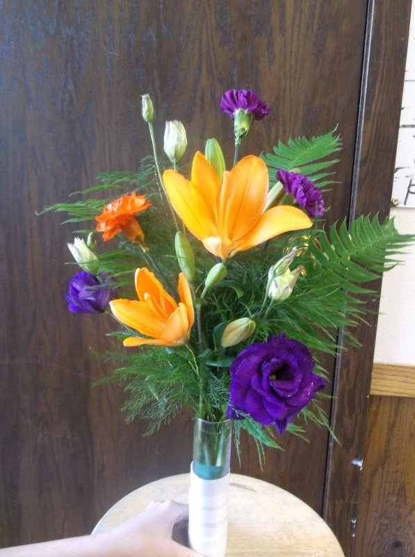 Vase arrangment of orange lilies, purple lizzy, mini carnations