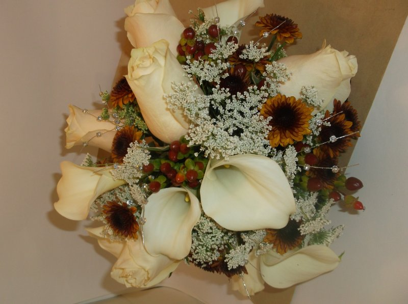 Fresh bouquet: calla lilies, off white roses, queen annes lace, buttons, hypericum berries, bling pieces