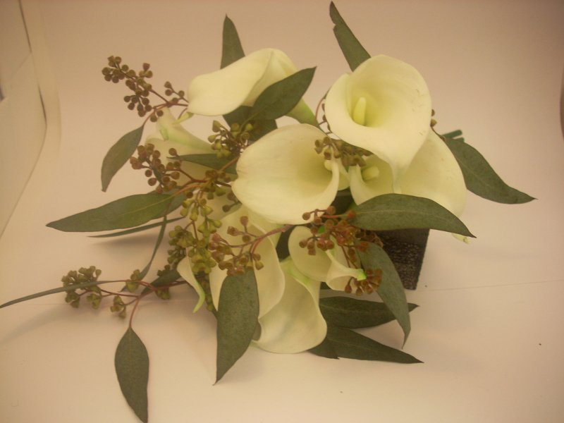 Silk calla lilies with fresh seeded eucalyptus