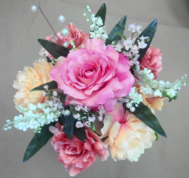 Silk center pieces:  roses, lilies of the valley, bling