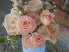 Bouquet of large and spray blush colored roses