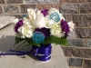fresh bouquet with white roses, white hydrangeas, purple carnations and teal spheres