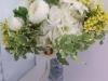 Fresh ranulunus, succulents, silk white hydrangea, yellow wax with keep sake